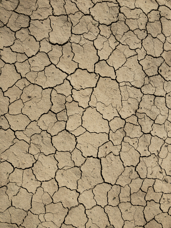 cracks on the soil and inefficiency Stock Photo