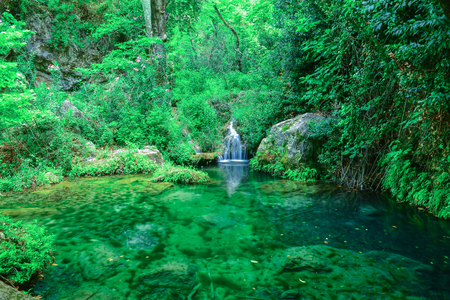 wild geography, waterfall and frequent woodlands Stock fotó - 101897901