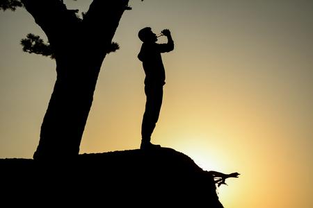 man silhouette drinking in the summer heat Stok Fotoğraf