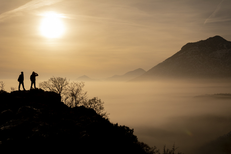 hazy, foggy and mixed mountain scenery and mountaineers adventures 写真素材