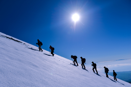 mountaineering march in challenging and inclined mountains 版權商用圖片
