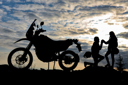 motorcyclist's marriage proposal and happiness concept 스톡 콘텐츠