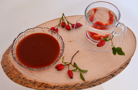 rosehip products on wooden presentation plate
