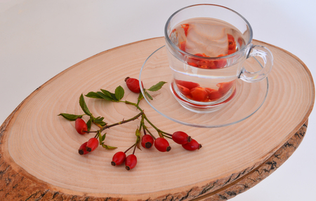 Rosehip tea on wooden menu plate