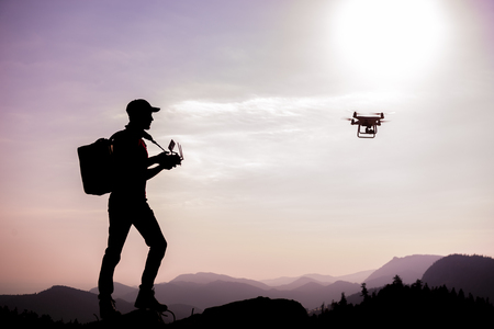 Man using of drone in mountains