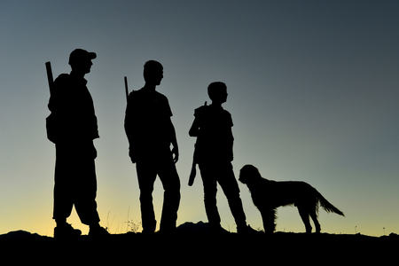 people hunting together using dog Stock Photo
