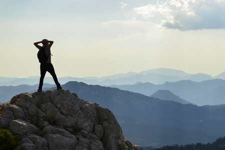 Climber enjoying mountain view after successful climb Stock Photo