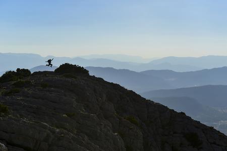Climber enjoying mountains view after successful climb Stockfoto