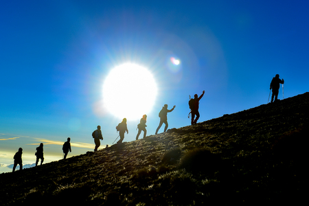 group of hikers walking together in the mountains
