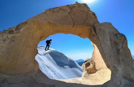 man walking on cliffs