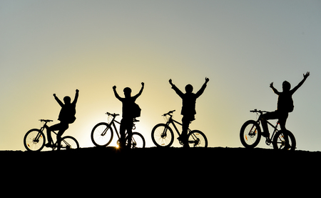 successful and fun cyclists group silhouette