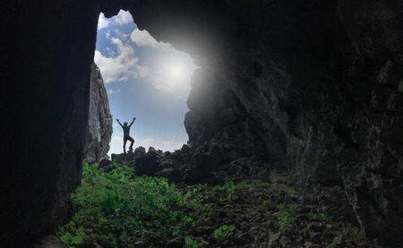 cave curiosity, love and the joy of successful discovery Stock Photo