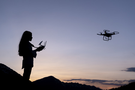 female drone user and trained person