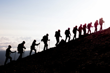 activities of crowded mountaineers, walking towards steep mountains and sporting activities Stock fotó