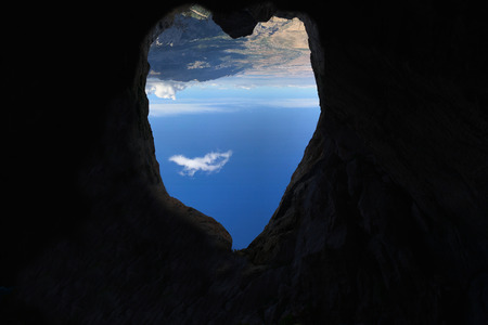 heart shape on cave in mountains