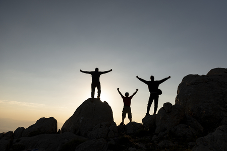 joy of success of three gene mountaineers Stok Fotoğraf