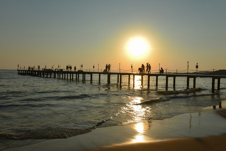 sea pier, people, walking and sunset time