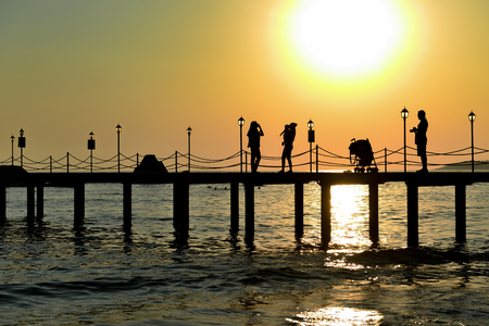 view of seaside and pier at sunset time Stok Fotoğraf