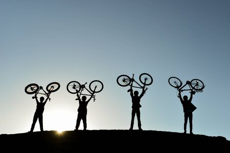 group of young people in stable, adventurous and successful cyclist
