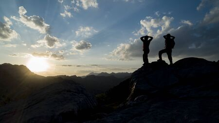 successful people looking proudly at the mountains Stock Photo - 128247783