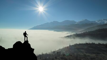 successful peak discovery on a spectacular mysterious day Stockfoto