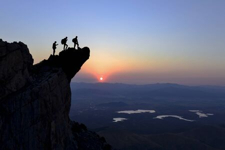 three friends watching the sunrise in the mountains of the mountains moments and spectacular views
