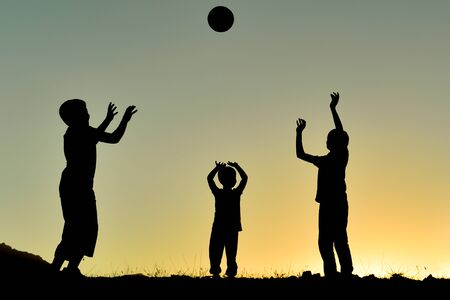 a frame describing the pleasant moments of an energetic group of children playing with the ball