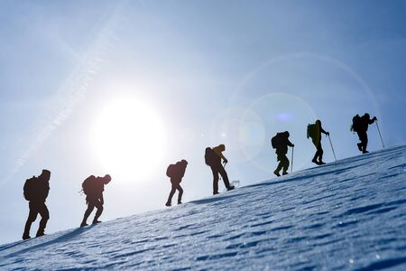 hiking, sports and adventure group on top mountains