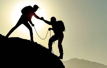 goal success & mountaineering help & mountaineering silhouette