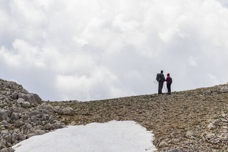 Concept of couple spending healthy time in nature and mountains