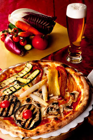 courgettes: Traditional italian pizza with fresh courgettes, white asparagus, mushrooms, tomato, yellow e red peppers