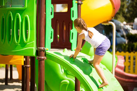 Girlie climbing on jungle gym