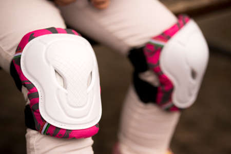 White roller knee protector pads. Close-up photo