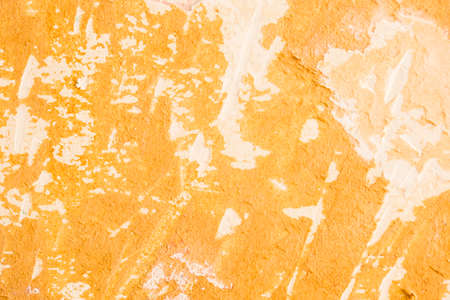 Old wall covered with two layers of cracked oil paint. Vintage retro background. Stock Photo