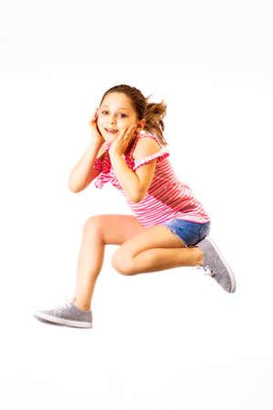 Little jumping caucasian girl on white background Stock Photo