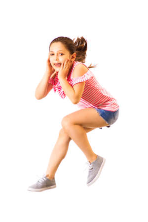 Little jumping caucasian girl with a headphones