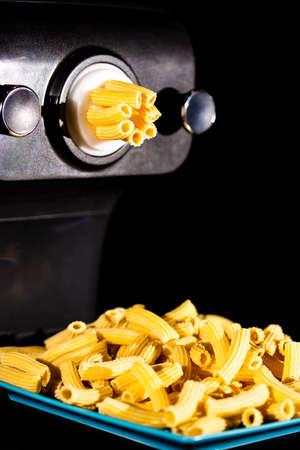 Home made rigatoni pasta by pasta maker Stock Photo