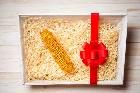 A shrivel dry corn cob in the gift box