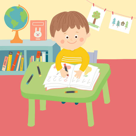 concentrate: Cute child in school classroom sitting at desk and writing.