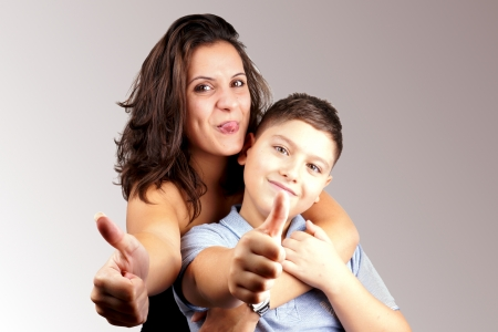Girl and young boy with thumbs up Stock Photo