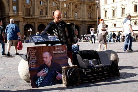 Street performer plays the accordion