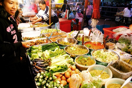 Chiang mai, Thailand - January 20, 2009  Customer buy food in a stall at the Chiang mai Night Market  Editorial
