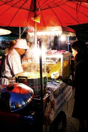 night market: Chiang mai, Thailand - January 20, 2009  Customer buy food in a stall at the Chiang mai Night Market  Editorial