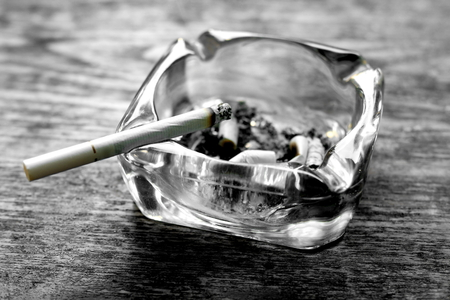 Cigarette and ashtray photo