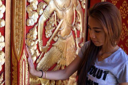 opens: Girl opens the door
