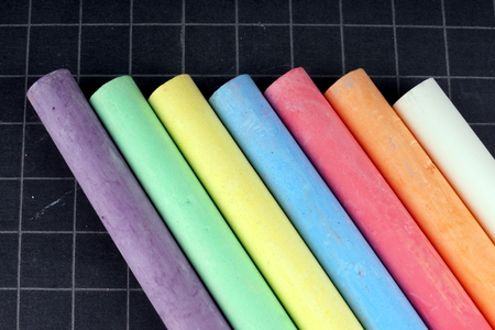 Blackboard and Coloured Chalks Stock Photo
