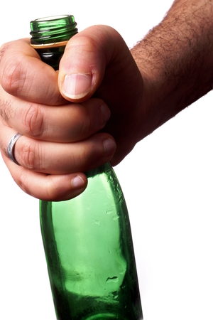 Hand Holding a green bottle photo