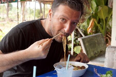 European Man Eating Thai food