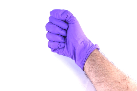 Hand wearing surgical glove photo