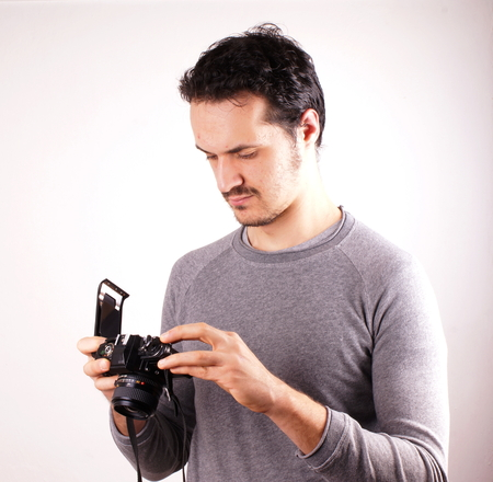snapping fingers: Man with analogic camera